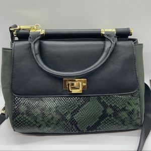 Faux leather and snakeskin crossbody bag.